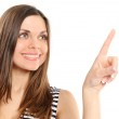 Young woman pointing out with finger — Stock Photo #2437488