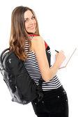Flicka med en ryggsäck, håller boken — Stockfoto