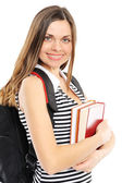 Girl with a backpack, holds the book — Stock Photo