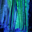 Illuminated stalactites - Stock Photo