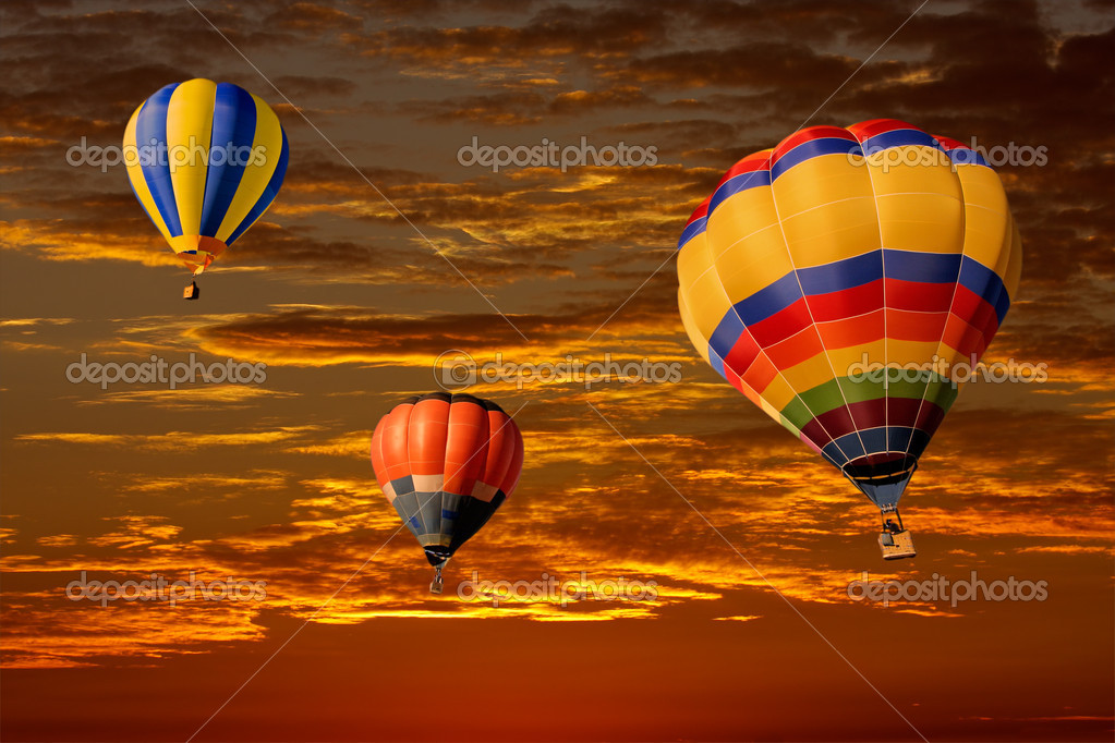 Colorful hot air balloons against a dramatic red sky — Stock Photo #1994728