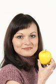 Attractive girl portrait with fruit — Stock Photo