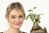Attractive girl portrait with plant — Stock Photo