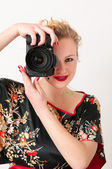 Attractive photographer girl portrait — Stock Photo