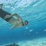 Man underwater snorkeling in tropical water — Stock Photo #1705895