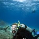 Woman scuba diving, Fiji — Stock Photo