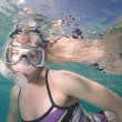 Attractive woman snorkeling underwater — Foto Stock