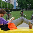 Man reading a book in the park — Stock Photo