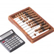 Old wooden abacus and modern calculator — Stock Photo