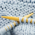 Knitting with bamboo needles — Stock Photo