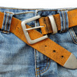 Blue jeans and leather belt — Stock Photo