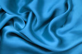 Blue satin textile background — Stock Photo