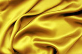 Golden silk textile background — Stock Photo