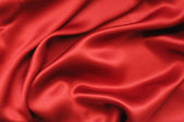 Red silk textile background — Stock Photo