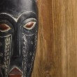 Stock Photo: Africmask over wooden background