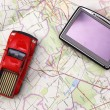 Stock Photo: GPS and car on map