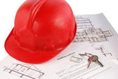 Keys and helmet on building contract — Stock Photo