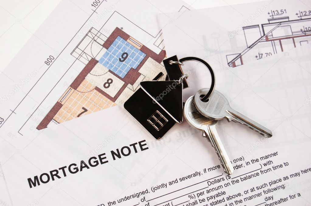 Keys on mortgage note and blueprints  Stock Photo #1707618