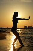 Sunset Tai Chi on a beach — Stock Photo