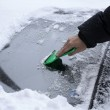 Removing Snow from the Car windshield — Stock Photo