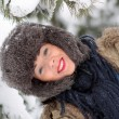 Stock Photo: Young Woman playing in the Snow