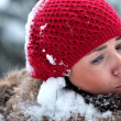 Woman is under attack of huge snowballs — Stock Photo