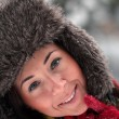 Foto Stock: Beautiful young woman laughing on snow