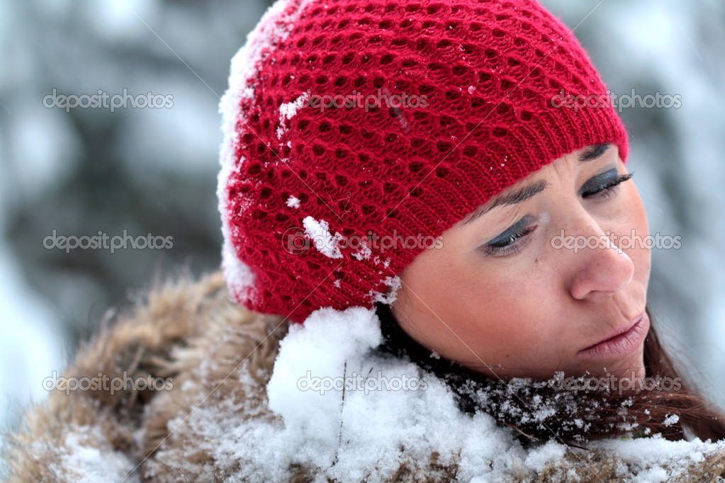 Woman is under attack of huge snowballs   Stock fotografie #1650640