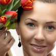 Woman with Colored Tulips — Stockfoto
