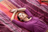 Woman laying on the bed — Stock Photo