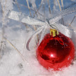Red ball on a snow — Stockfoto