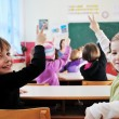 Happy children group in school — Stock Photo #1671193