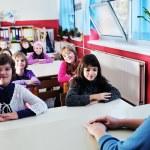 Happy children group in school — Stock Photo