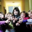 Happy children group in school - Stock Photo