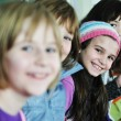 Happy children group in school — Stock Photo