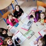 Happy children group in school — Stock Photo #1671748