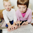 Royalty-Free Stock Photo: Children playing games on laptop