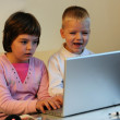 Children playing games on laptop — Stock Photo