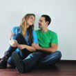 Happy couple in empty apartment — Stock Photo