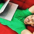 Man relaxing on sofa and work on laptop — Stock Photo #1674083