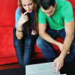 Happy couple have fun on laptop at home — Stock Photo #1674110