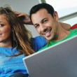 Royalty-Free Stock Photo: Happy couple have fun on laptop at home