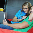 Happy couple have fun on laptop at home — Stock Photo