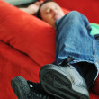 Man relaxing on sofa — Stock Photo