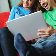 Happy couple have fun on laptop at home — Stock Photo #1674243