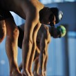Stock Photo: Young swimmmer on swimming start