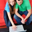Royalty-Free Stock Photo: Couple have fun on laptop at home