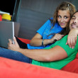 Couple have fun on laptop at home — Stock Photo