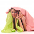 Young girls under blanket smile — Stock Photo #1678006