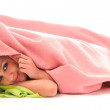 Young girls under blanket smile - Stock Photo